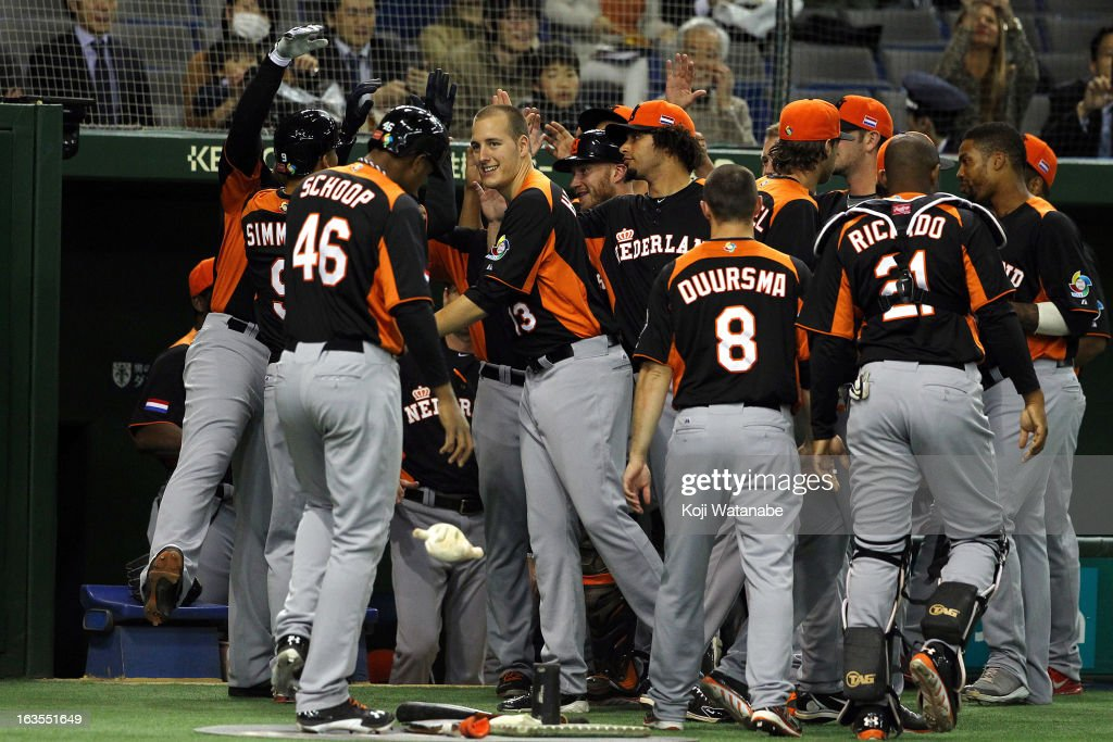 Infielder Andrelton Simmons #9 of the Netherlands celebrates with team-mates after scoring a homerun in the top half of the first inning during the World Baseball Classic Second Round Pool 1 game between Japan and the Netherlands at Tokyo Dome on March 12, 2013 in Tokyo, Japan.