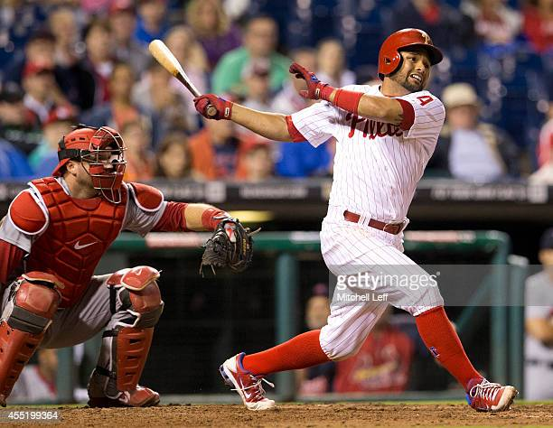 Infielder Andres Blanco of the Philadelphia Phillies swings the bat against the St Louis Cardinals on August 23 2014 at Citizens Bank Park in...