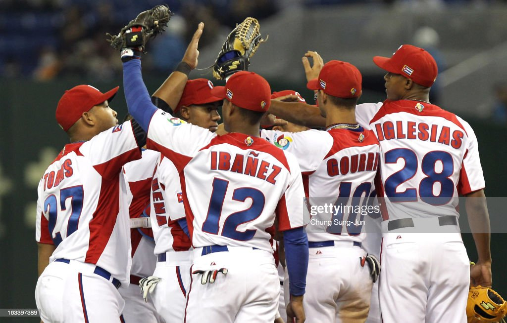 Infielder Andy Ibanez # 12, Yasmany Tomas # 27, Yulieski Gourriel # 10, pitcher Raciel Iglesias # 28 and other players celebrate victory over Chinese Taipei in the World Baseball Classic Second Round Pool 1 game between Chinese Taipei and Cuba at Tokyo Dome on March 9, 2013 in Tokyo, Japan.