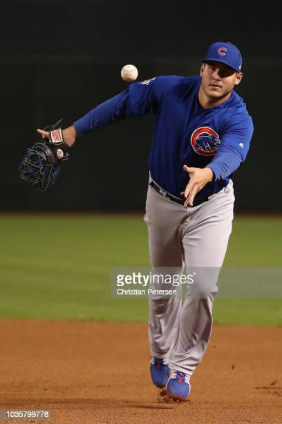 Infielder Anthony Rizzo of the Chicago Cubs fields a ground ball out against the Arizona Diamondbacks during the fourth inning of the MLB game at...