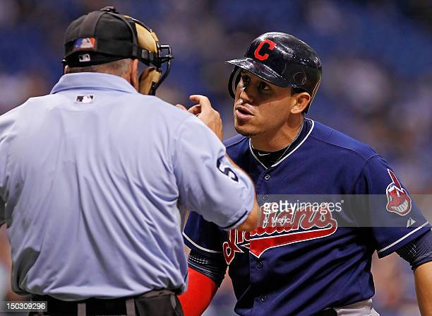 Infielder Asdrubal Cabrera of the Cleveland Indians questions homeplate umpire Dale Scott during the game against the Tampa Bay Rays at Tropicana...