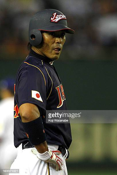 Infielder Atsunori Inaba of Japan celebrates after hits a single in the top half of the seventh inning during the World Baseball Classic Second Round...