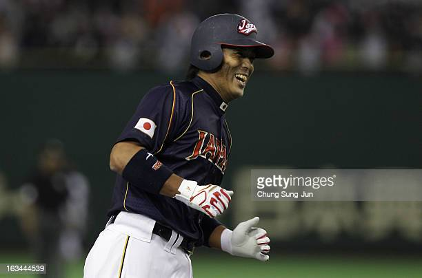 Infielder Atsunori Inaba of Japan reacts after hits solo home run top of the third inning during the World Baseball Classic Second Round Pool 1 game...