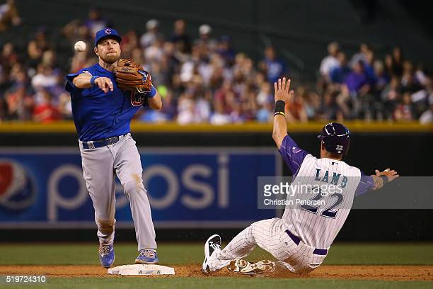 Infielder Ben Zobrist of the Chicago Cubs throws over the sliding Jake Lamb of the Arizona Diamondbacks to complete a double play during the sixth...