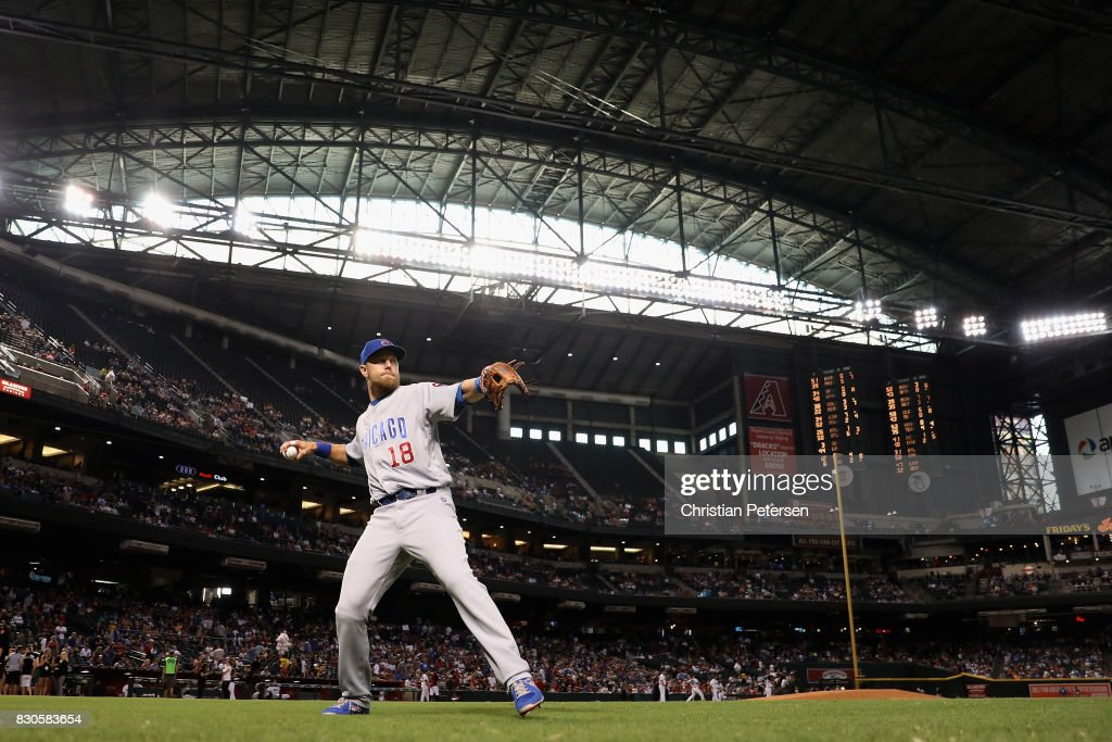 Infielder Ben Zobrist #18 of the Chicago Cubs warms up on the field before the MLB game against the Arizona Diamondbacks at Chase Field on August 11, 2017 in Phoenix, Arizona.