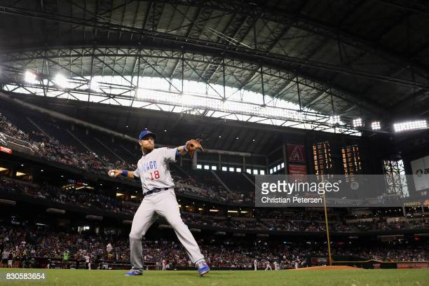 Infielder Ben Zobrist of the Chicago Cubs warms up on the field before the MLB game against the Arizona Diamondbacks at Chase Field on August 11 2017...