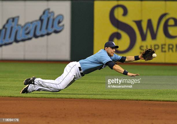 Infielder Ben Zobrist of the Tampa Bay Rays dives for a ground ball against the St Louis Cardinals July 3 2011 at Tropicana Field in St Petersburg...
