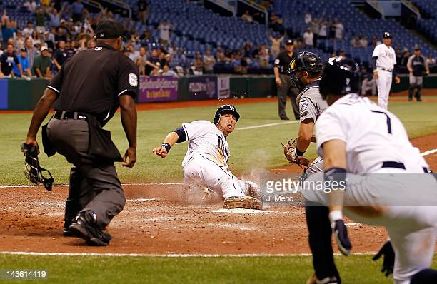 Infielder Ben Zobrist of the Tampa Bay Rays scores the game winning run against the Seattle Mariners at Tropicana Field on April 30 2012 in St...