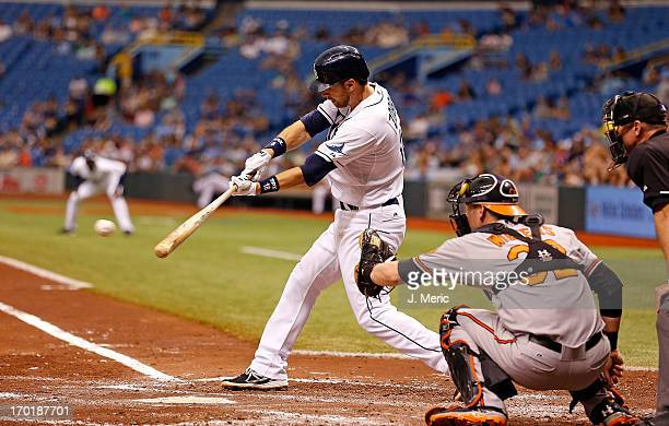 Infielder Ben Zobrist of the Tampa Bay Rays singles in a run in the second inning against the Baltimore Orioles during the game at Tropicana Field on...
