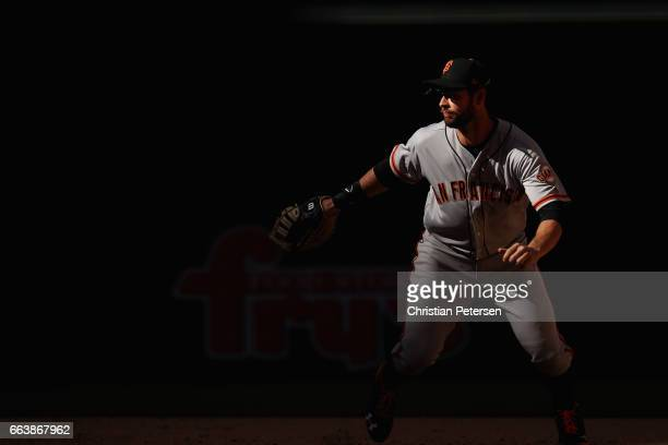 Infielder Brandon Belt of the San Francisco Giants covers first base during the MLB opening day game against the Arizona Diamondbacks at Chase Field...