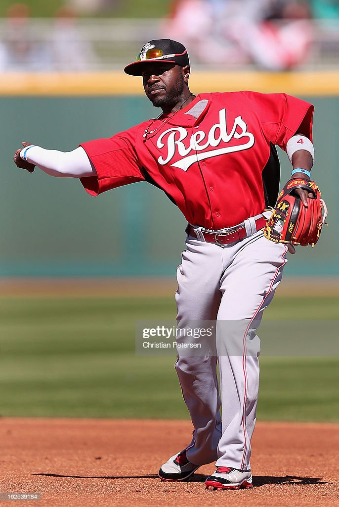 Infielder Brandon Phillips #4 of the Cincinnati Reds fields a ground ball out against the Cleveland Indians during the spring training game at Goodyear Ballpark on February 24, 2013 in Goodyear, Arizona