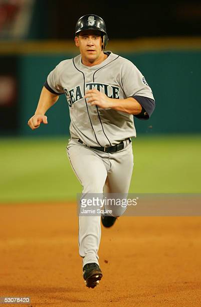 Infielder Bret Boone of the Seattle Mariners runs the baseline during the game against the Florida Marlins on June 8 2005 at Dolphin Stadium in Miami...