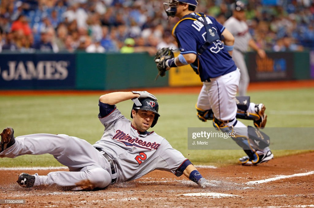 Infielder Brian Dozier #2 of the Minnesota Twins slides in for a run in the sixth inning against the Tampa Bay Rays during the game at Tropicana Field on July 11, 2013 in St. Petersburg, Florida.