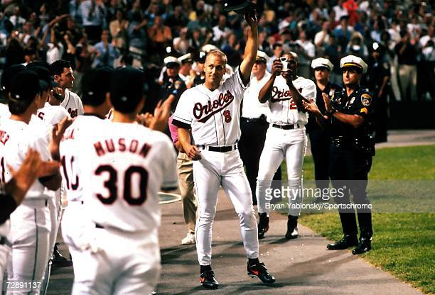 Infielder Cal Ripken Jr. Of the Baltimore Orioles tips his cap to the fans after breaking Lou Gherig's record of 2130 consecutive games played on...