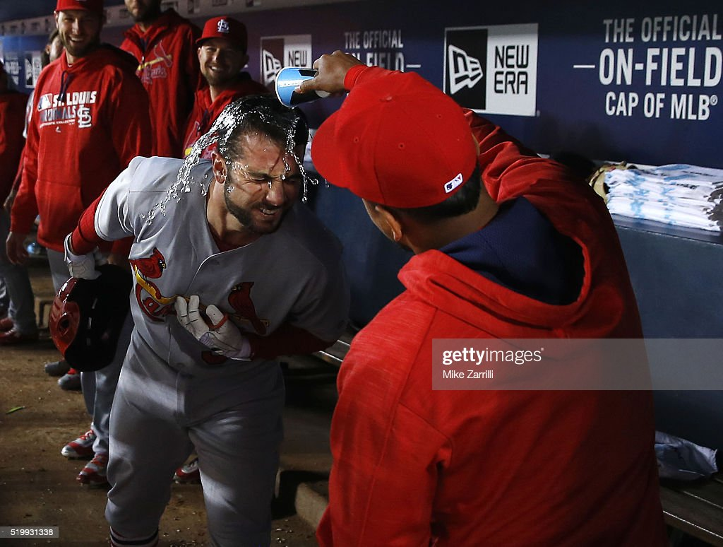Infielder Carlos Martinez #18 of the St. Louis Cardinals dumps water on pinch hitter Greg Garcia #35 after Garcia's ninth inning home run during the game against the Atlanta Braves at Turner Field on April 8, 2016 in Atlanta, Georgia.