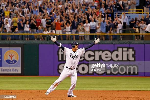 Infielder Carlos Pena of the Tampa Bay Rays celebrates his walkoff hit against the New York Yankees during the Opening Day game at Tropicana Field on...