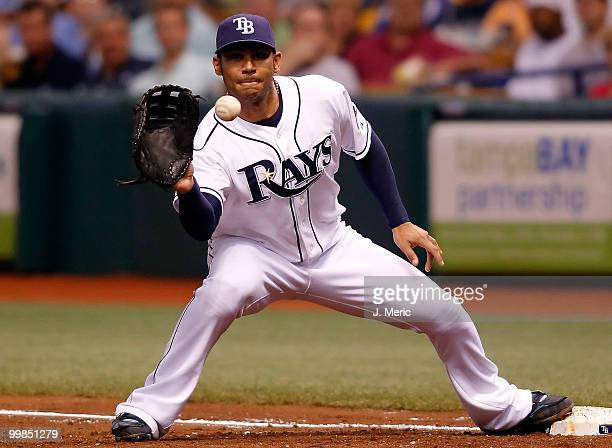 Infielder Carlos Pena of the Tampa Bay Rays takes the throw at first base against the Cleveland Indians during the game at Tropicana Field on May 17...
