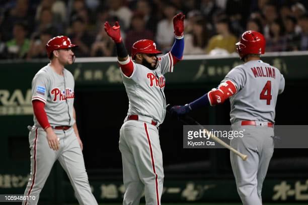 Infielder Carlos Santana of the Philadelhia Phillies celebrates hitting a threerun home run to make it 41 with his team mate Designated hitter Rhys...