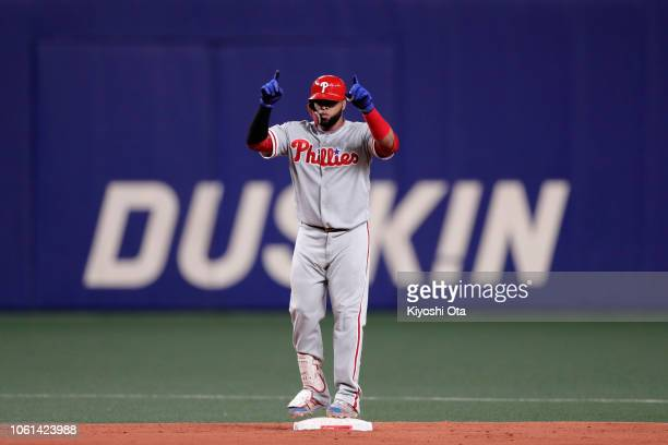Infielder Carlos Santana of the Philadelhia Phillies hits a double in the top of 8th inning during the game five between Japan and MLB All Stars at...
