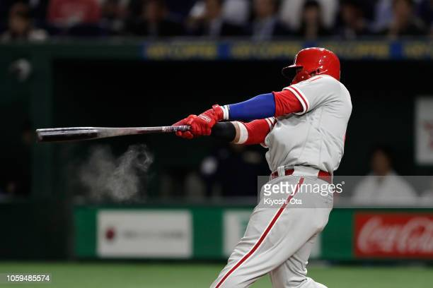 Infielder Carlos Santana of the Philadelhia Phillies hits a three-run home run to make it 4-1 in the top of 5th inning during the game one of the...