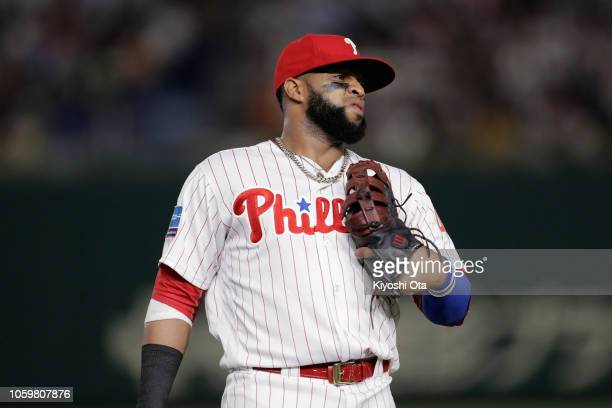 Infielder Carlos Santana of the Philadelhia Phillies reacts after a throwing error by Enrique Hernandez of the Los Angeles Dodgers in the top of 5th...