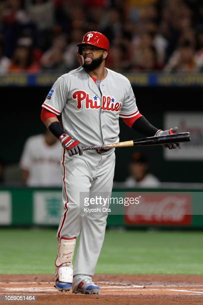 Infielder Carlos Santana of the Philadelhia Phillies reacts after strike out in the top of 1st inning during the exhibition game between Yomiuri...