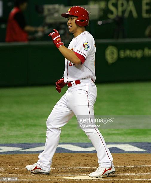 Infielder Chang Ray of China scores a solo home run in the bottom of eighth inning during the World Baseball Classic Tokyo Round match between China...