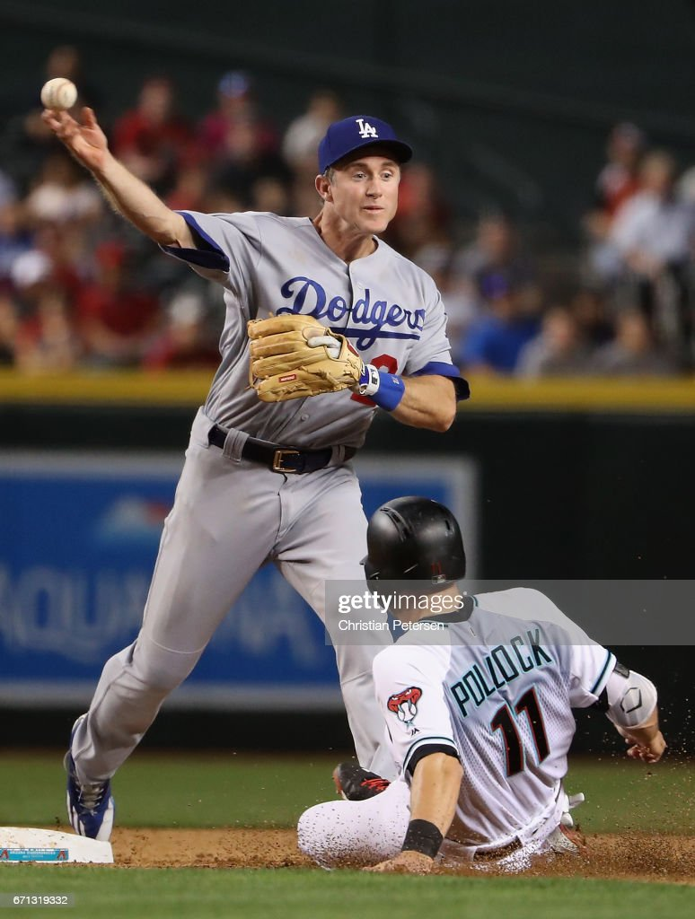 Infielder Chase Utley #26 of the Los Angeles Dodgers throws over the sliding Tony Perezchica #1 of the Arizona Diamondbacks attempting an unsuccessful double play during the fifth inning of the MLB game at Chase Field on April 21, 2017 in Phoenix, Arizona.