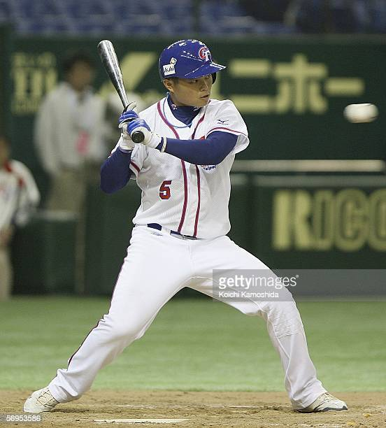 Infielder ChingLung Hu of Chinese Taipei watches tha ball during the 2006 World Baseball Classic Exhibition Game against Chiba Lotte Marines at Tokyo...
