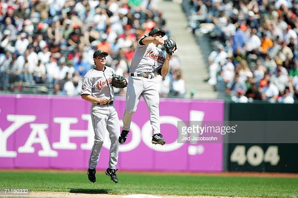 Infielder Chris Burke of the Houston Astros makes a throw against the San Francisco Giants at ATT Park on April 13 2006 in San Francisco California...