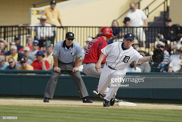 Infielder Chris Shelton of the Detroit Tigers attempts a pick off play against the Washington Nationals during a Spring Training game on March 7 2005...