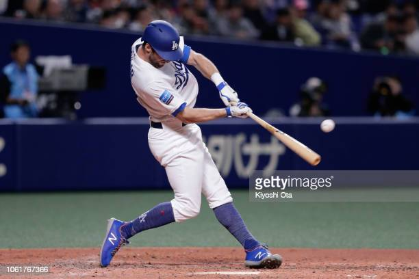 Infielder Chris Taylor of the Los Angeles Dodgers hits a single in the bottom of 5th inning during the game six between Japan and MLB All Stars at...