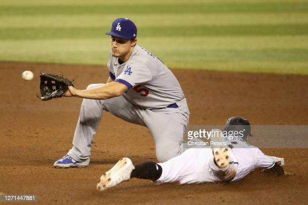 Infielder Corey Seager of the Los Angeles Dodgers catches the throw as Tim Locastro of the Arizona Diamondbacks safely steals second base during the...