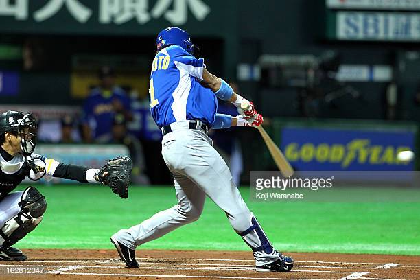 Infielder Daniel Matsumoto of Brazil hits a single in the top half of the first inning during the friendly game between Fukuoka Softbank Hawks and...