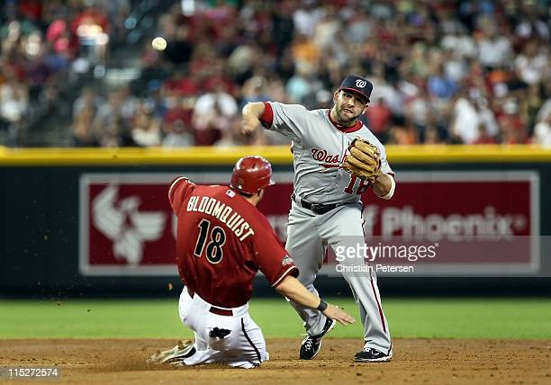 Infielder Danny Espinosa of the Washington Nationals throws over the sliding Willie Bloomquist of the Arizona Diamondbacks to complete a double play...