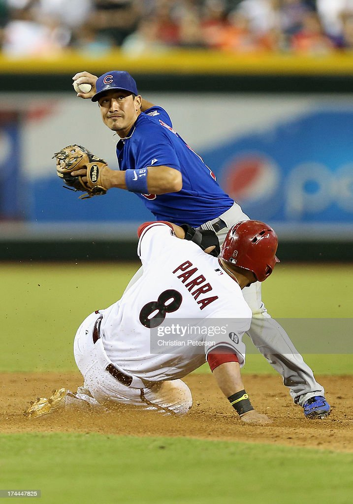 Infielder Darwin Barney #15 of the Chicago Cubs throws over the sliding Gerardo Parra #8 of the Arizona Diamondbacks to complete a double play during the eighth inning of the MLB game at Chase Field on July 25, 2013 in Phoenix, Arizona. The Diamondbacks defeated the Cubs 3-1.