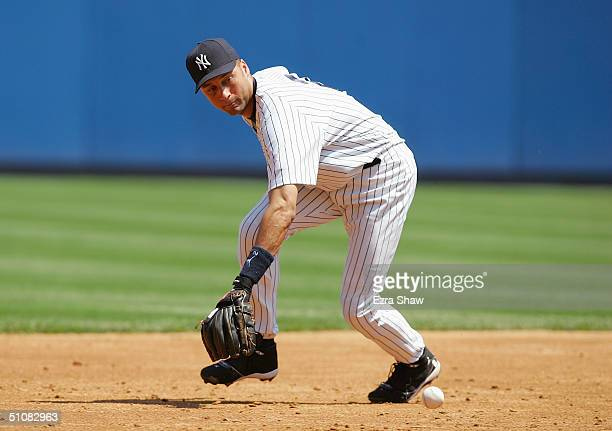 Infielder Derek Jeter of the New York Yankees catches the ball against the Detroit Tigers during the game at Yankee Stadium on July 7, 2004 in the...