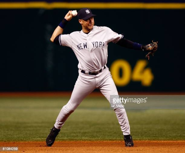 Infielder Derek Jeter of the New York Yankees makes the play at short against the Tampa Bay Rays during the game on May 13, 2008 at Tropicana Field...