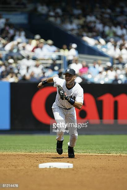 Infielder Derek Jeter of the New York Yankees runs during the game against the Toronto Blue Jays at Yankee Stadium on August 9 2004 in the Bronx New...