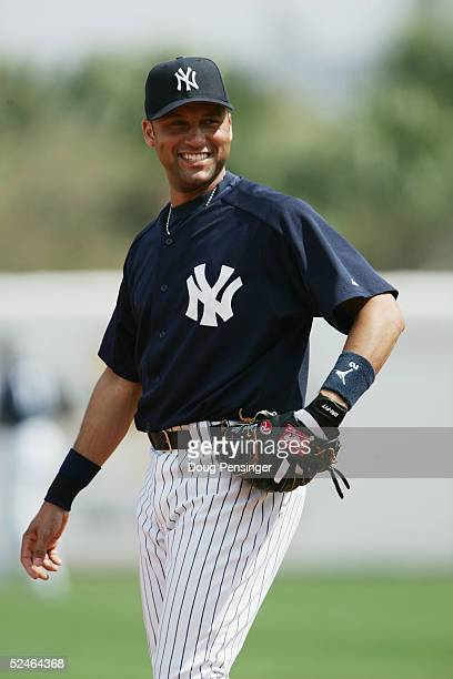 Infielder Derek Jeter of the New York Yankees smiles during an MLB Spring Training game against the Cleveland Indians at Legends Field on March 7...