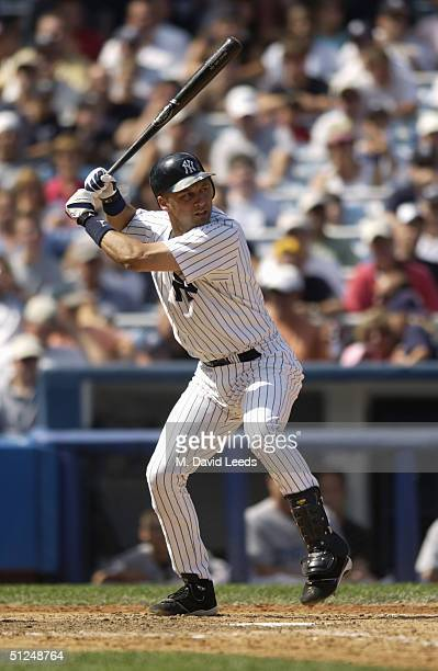 Infielder Derek Jeter of the New York Yankees swings at a Toronto Blue Jays pitch during the game at Yankee Stadium on August 9 2004 in the Bronx New...