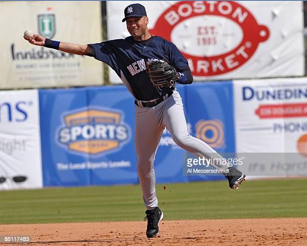 Infielder Derek Jeter of the New York Yankees throws out a runner against the Toronto Blue Jays February 25 2009 at Dunedin Stadium in Dunedin Florida