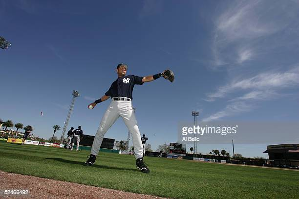 Infielder Derek Jeter of the New York Yankees warmsup for the Pre Season game against the Detroit Tigers on March 5 2005 at Joker Merchant Stadium in...