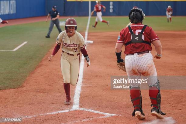 Infielder Devyn Flaherty of the Florida St. Seminoles reacts as she scores during the third inning of Game 14 of the Women's College World Series...