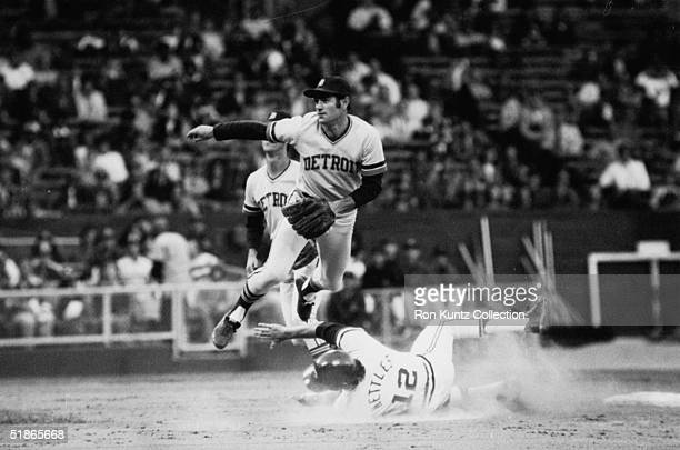 Infielder Dick McAuliffe of the Detroit Tigers turns the double play as Graig Nettles of the Cleveland Indians tries to upend him during a game on...