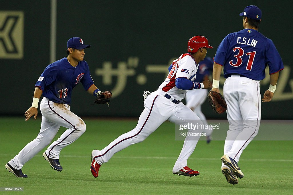 Infielder Erisbel Arruebarruena #11 of Cuba is chased down during the World Baseball Classic Second Round Pool 1 game between Chinese Taipei and Cuba at Tokyo Dome on March 9, 2013 in Tokyo, Japan.