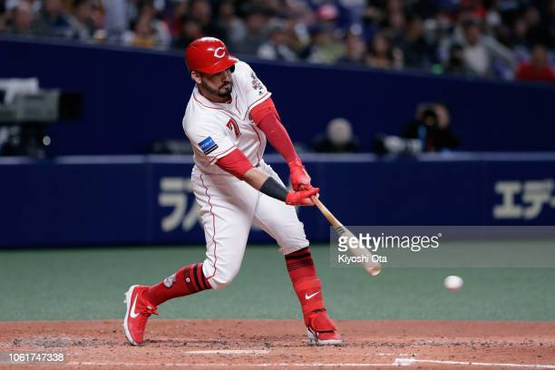Infielder Eugenio Suarez of the Cincinnati Reds hits a single in the bottom of 4th inning during the game six between Japan and MLB All Stars at...