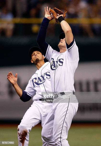 Infielder Evan Longoria of the Tampa Bay Rays catches a foul ball as shortstop Jason Bartlett is there to back him up against the Minnesota Twins...