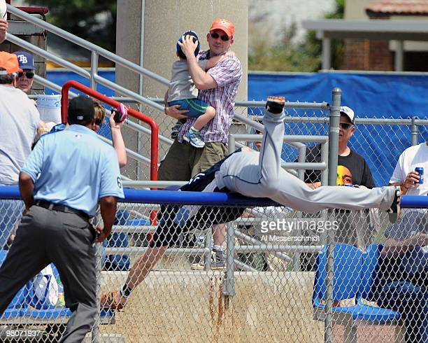 Infielder Evan Longoria of the Tampa Bay Rays dives over the fence against the Toronto Blue Jays March 26, 2010 at Dunedin Stadium in Dunedin,...