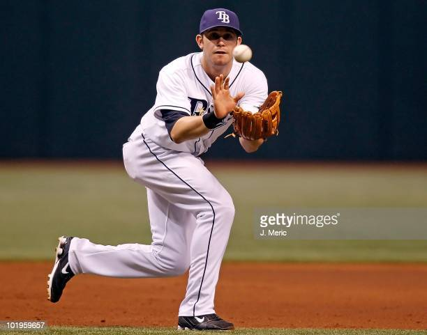 Infielder Evan Longoria of the Tampa Bay Rays fields a ground ball against the Toronto Blue Jays during the game at Tropicana Field on June 8 2010 in...